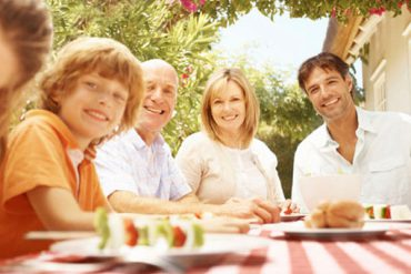 picture of a family at a picnic table