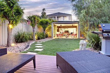 image of a backyard leading to an open style house den